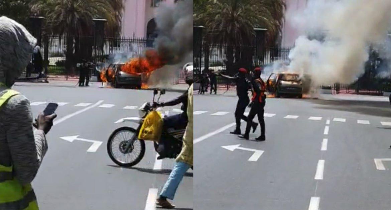 Une voiture prend feu devant le palais de la République